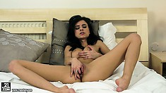 Horny, lonely brunette takes matters into hand as she masturbates