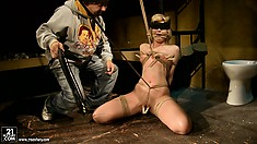 Blonde is all trussed up and he puts clothespins all over her