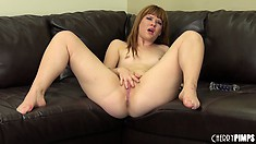 Claire lies on the couch fingering her tight pussy and driving it to climax
