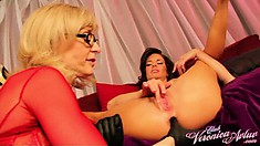 Nina Hartley slowly but surely sticks her fingers deep in her friend's sweet holes