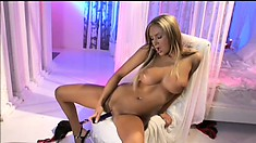 Distinctive blonde with perfect tits Amy Reid sends a dildo driving her twat to climax