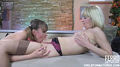 Lustful blonde cougar and sexy brunette teen enjoy the taste of each other's twats