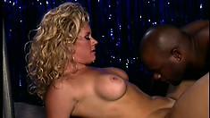 Insatiable black buck screws an older blonde stripper on stage