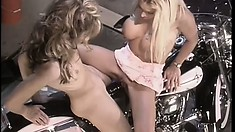 Delightful lesbians drill each other's cunts at the same time on the motorcycle