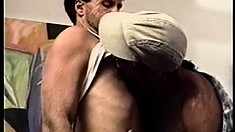 Paul Carrigan strokes his own dick while his hairy friend drills his ass