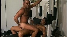 Hunky boys share hot kisses, blow each other's dicks and enjoy anal sex in the gym