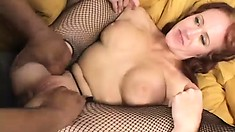Busty redhead cougar Bailey O'Dare needs two cocks to satisfy her needs