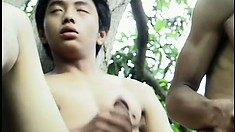 Two cute Asian boys fuck hard in the outdoors before cumming together