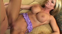 Sexy blonde with huge boobs munches on his stiffy and takes a ride