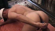 Sexy guy drives a big dildo in and out of his ass and strokes his dick