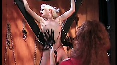 Skinny blond slavegirl gets tied up, suspended, tortured and whipped