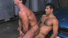 Hairy and horny auto mechanics get all hot and bothered in a garage