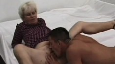 Grey haired granny with big titties gets a young buck pounding her old twat