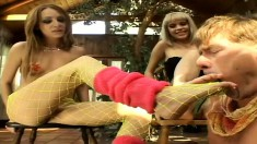 Kyle Stone gets his big cock stroked by the feet of two hot babes