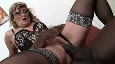 Lustful mature blonde in sexy lingerie gives a huge black stick a try