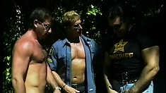 Two hunky policemen get their meat blown by a submissive sucker