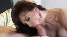 Huge breasted redhead milf in black stockings gets fucked on the bed