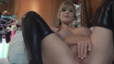 Horny MILF uses a dildo to make her amazing meat wallet all wet
