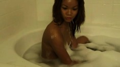 Lovely young Kim shows off her sexy curves while taking a bath