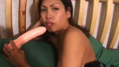Sensual Asian babe in lingerie Kim Serey takes her wet pussy to climax
