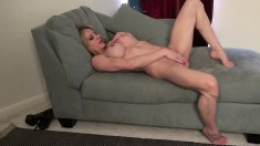 Big breasted blonde milf Raquel plays with her big clit on the couch