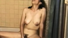 Jerilyn gets naked and works her own tight cunt for the camera