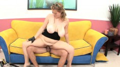 Sierra gets nailed from behind and works a cock with her tits