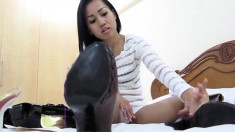 Seductive babe has a shoe fetish and loves to show you her collection