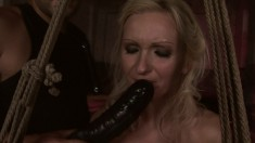 Beautiful bondage fetishist Angela deepthroats and fucks a large dick