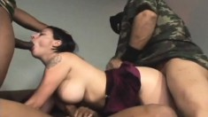 Luscious brunette with big hooters gets punished by four black studs