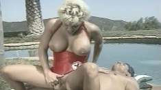 Super hot busty blonde blows his rod and rides on it under the sun