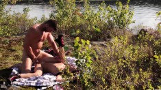 Two attractive young babes share a throbbing stick under the hot sun