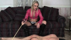 Submissive Boy Getting Whipped By A Ravishing Blonde In Black Boots
