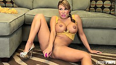 Sitting on the floor, the dazzling milf pleases her hungry twat with a pink dildo
