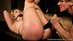 Shy Shay is tied up legs in the air getting fucked and toyed, with a cumshot