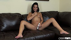 The tanned hottie plays with her pussy using her fingers and a white dildo