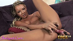 She has two dildos, one in her pussy and the thick one in her ass
