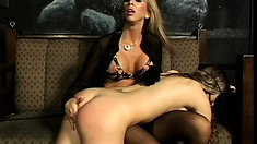Fit blonde mistress gives her bad slave a lesson in how to behave