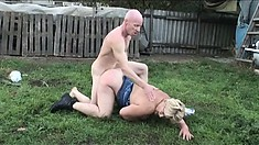 Blonde granny is a nasty whore getting banged in the grass by baldy
