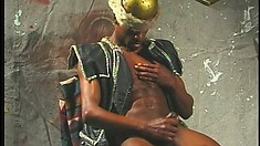 Black gladiator strokes his huge cock until he finds intense pleasure