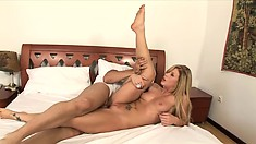 On the bed, a striking blonde with sexy tits sucks and fucks a big cock
