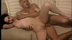 Slim brunette spreads her body across the couch and gets fucked deep