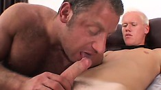 This bottle blond twink shares blowjobs with his old dude friend