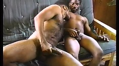 Strapping black studs sit side by side and jerk their wankers then get touchy feely with each other
