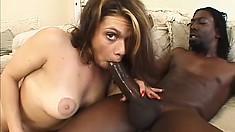 Slutty brunette with big tits finds intense pleasure in a black cock