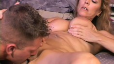 Captivating mature bitch is tasting the dick of tattooed gent