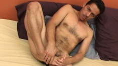 Hot latino hunk Jesus strokes his shaft with his hands and feet