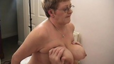 Big fat granny with huge knockers gets a younger prick to eat and fuck her