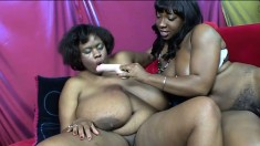 Chunky black lesbians taste each other's twats and share a dildo to reach their climax