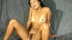 Asian cutie with tiny tits shows off her hairy snatch and perky ass